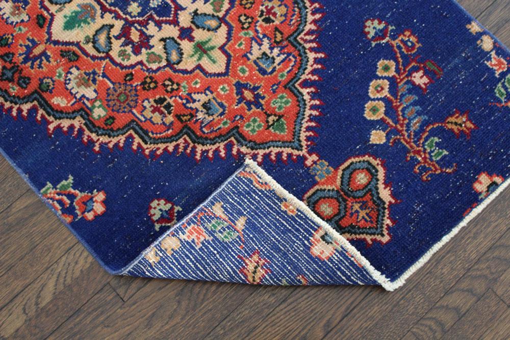 Blue And Orange Patterned Vintage Turkish Rug Angle 2