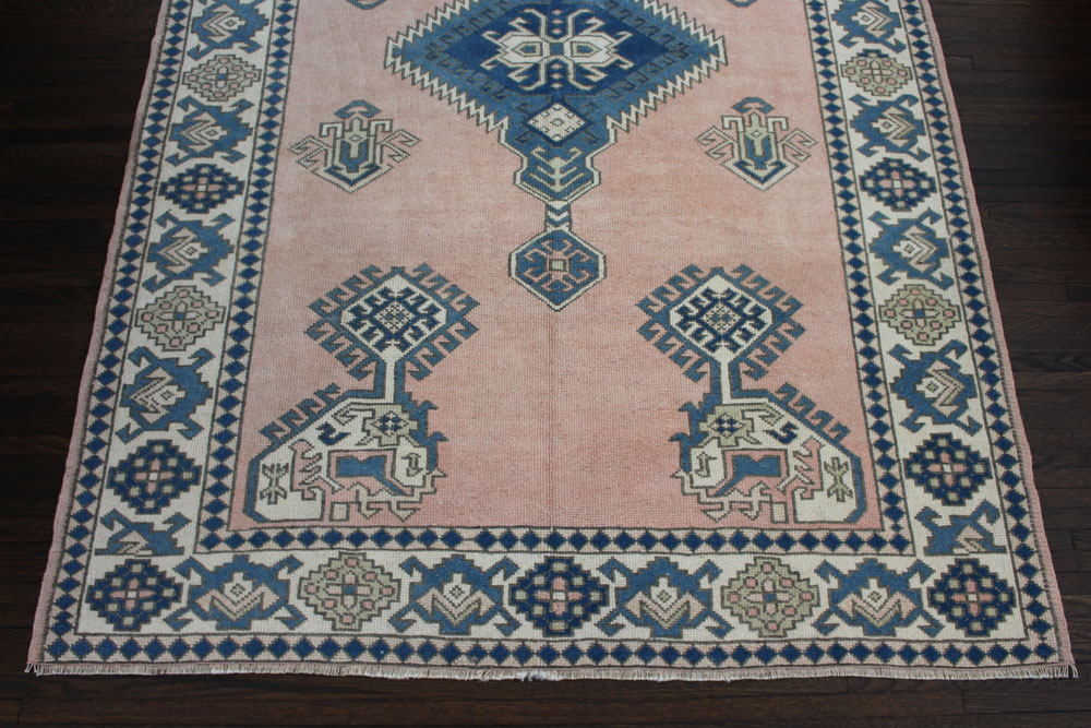 Blue And Peach Patterned Vintage Turkish Area Rug Angle 1