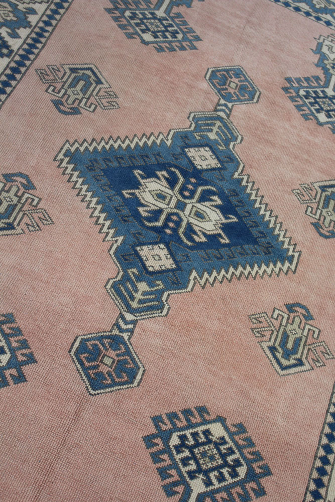 Blue And Peach Patterned Vintage Turkish Area Rug Angle 2