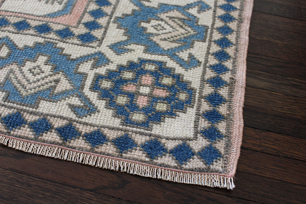 Blue And Peach Patterned Vintage Turkish Area Rug Angle 3