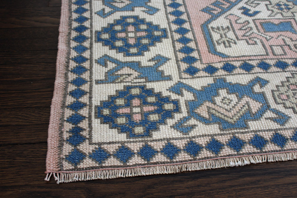Blue And Peach Patterned Vintage Turkish Area Rug Angle 4