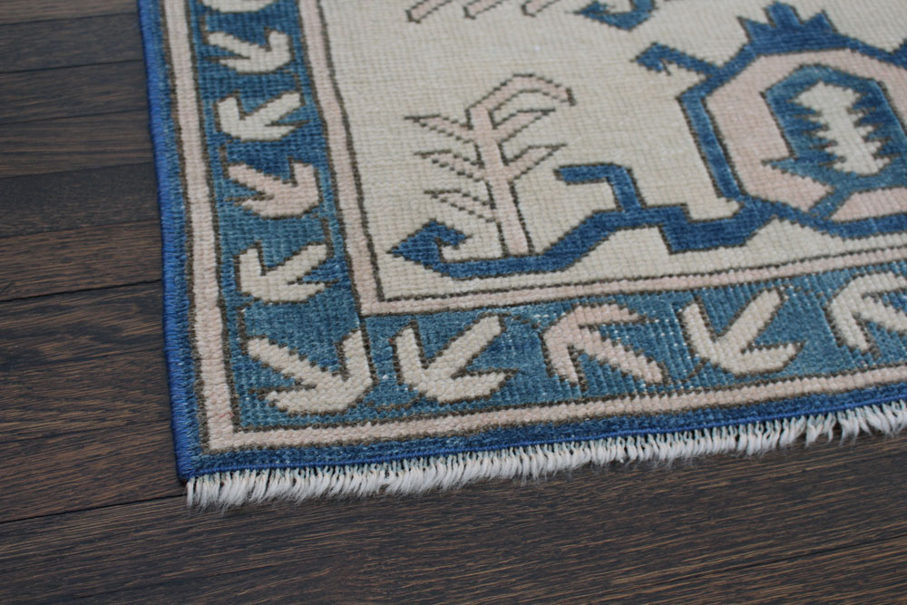 Blue And White Patterned Vintage Turkish Area Rug Angle 4