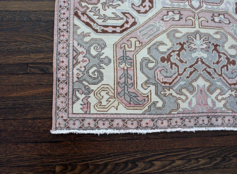 Pink And Mauve Patterned Vintage Turkish Area Rug Angle 1