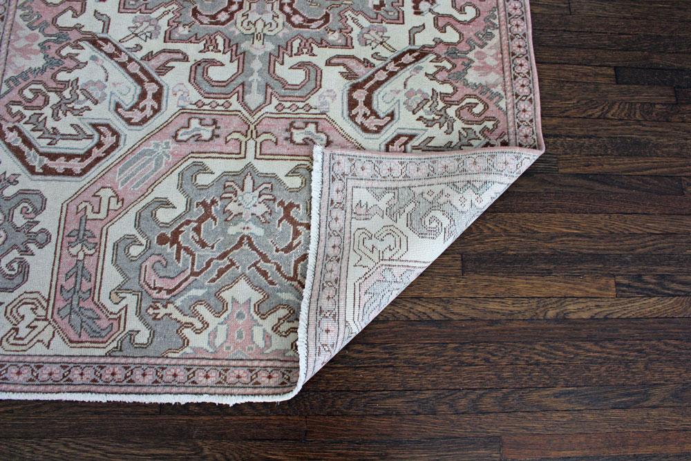 Pink And Mauve Patterned Vintage Turkish Area Rug Angle 3