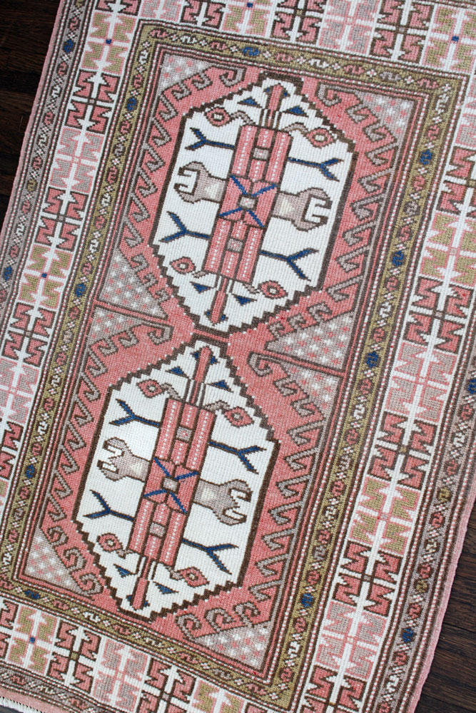 Pink And White Patterned Vintage Turkish Rug Angle 1