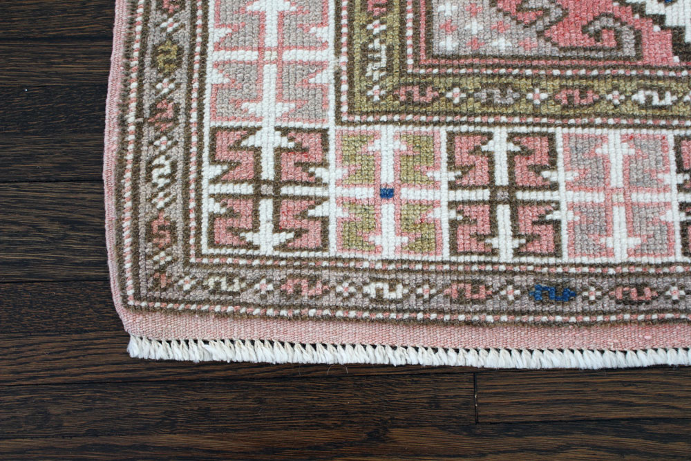 Pink And White Patterned Vintage Turkish Rug Angle 3