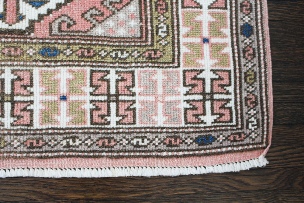 Pink And White Patterned Vintage Turkish Rug Angle 4