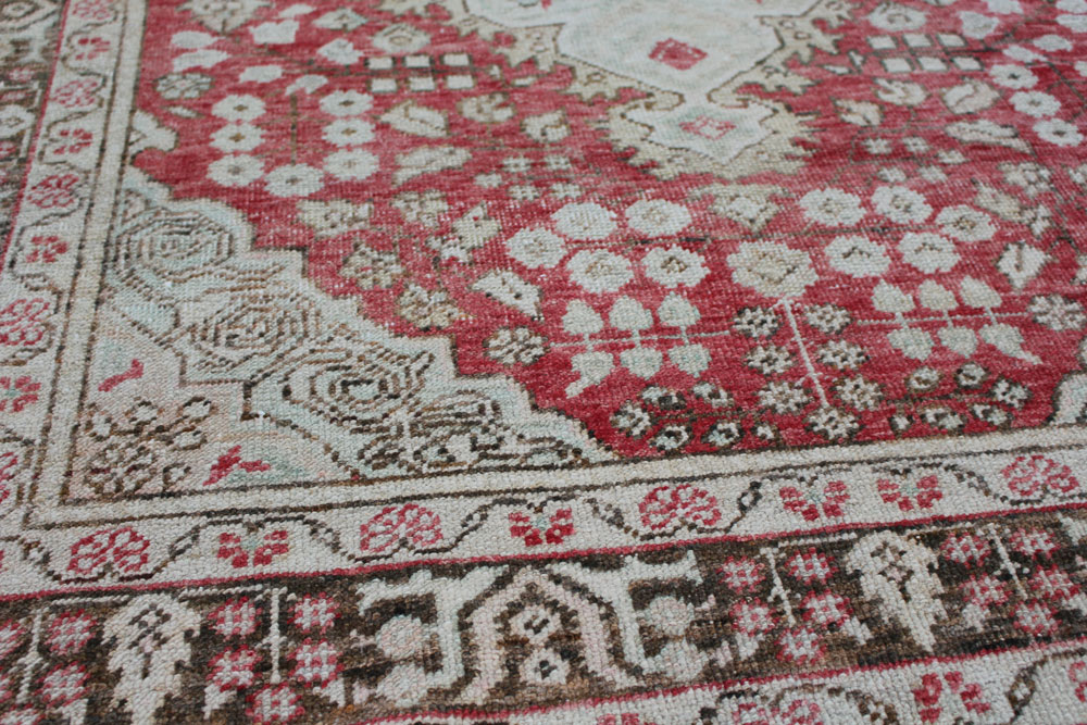 Red And Brown Patterned Vintage Turkish Area Rug Angle 1