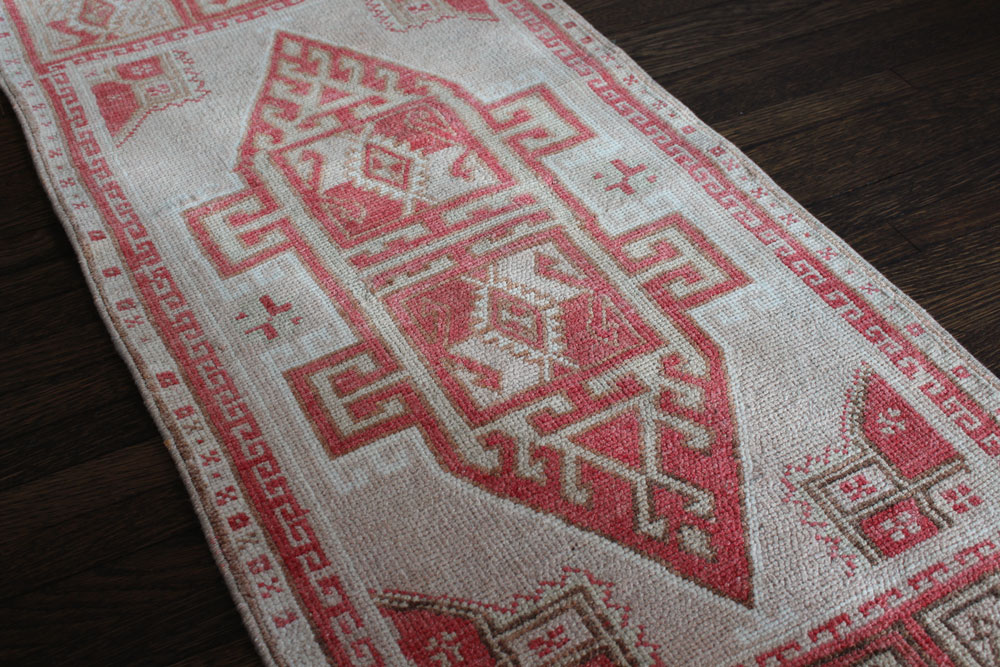 Red And White Patterned Vintage Turkish Scatter Rug Angle 1