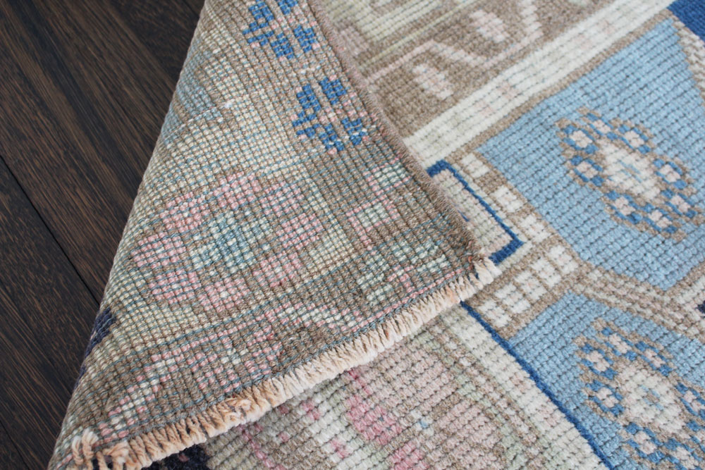 Blue And Neutral Patterned Fay + Belle Area Rug Angle 2