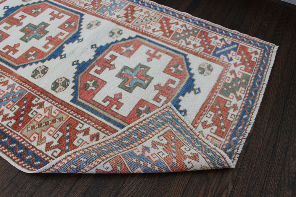 Blue And Red Patterned Vintage Turkish Area Rug Angle 1