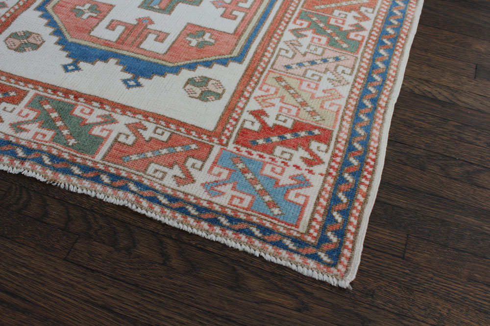 Blue And Red Patterned Vintage Turkish Area Rug Angle 2