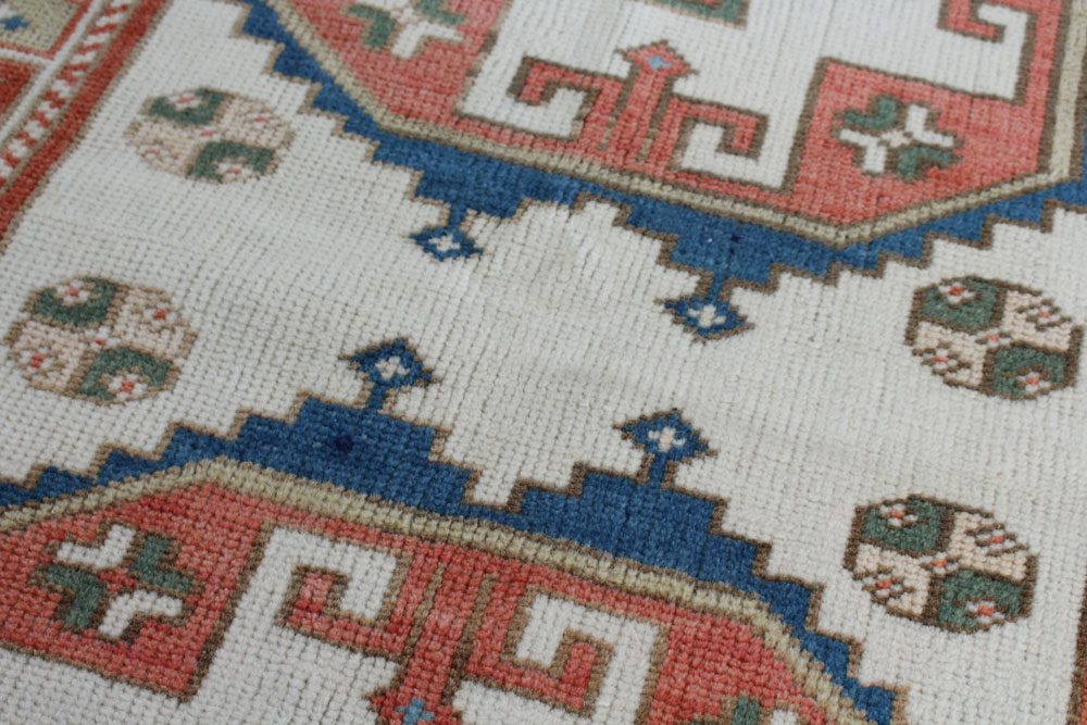 Blue And Red Patterned Vintage Turkish Area Rug Angle 3