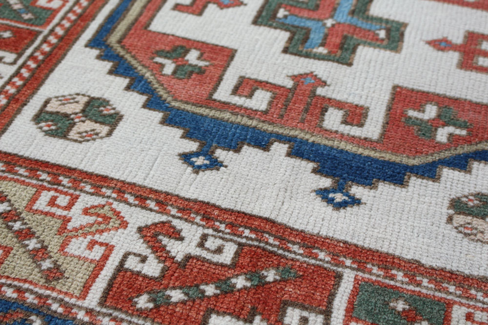 Blue And Red Patterned Vintage Turkish Area Rug Angle 4