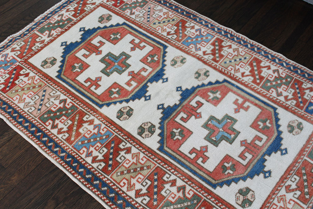 Blue And Red Patterned Vintage Turkish Area Rug Angle 5